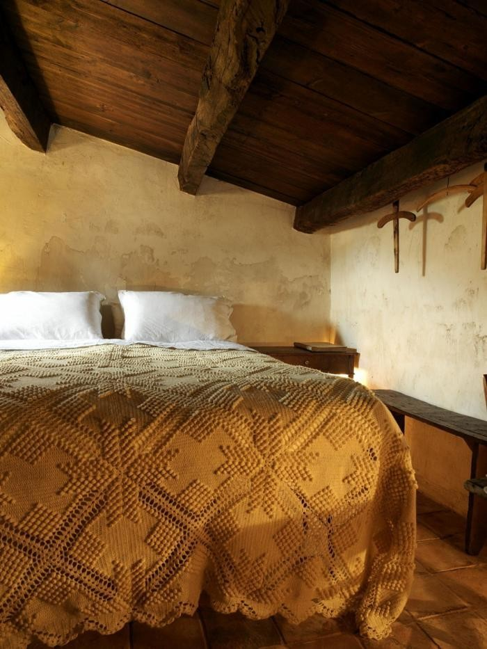 Yellow Crochet Blanket in Bedroom of Sectantio Hotel in Italy, Remodelista